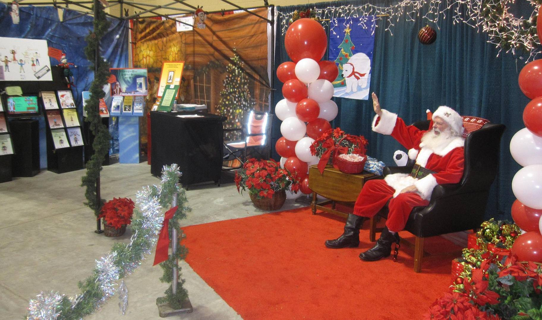 Santa and our booth in Charleston